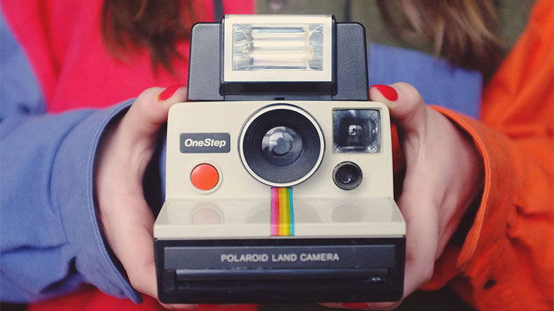 How Do Polaroid Cameras Print The Image On Paper?